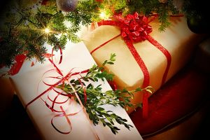 Christmas gifts with ribbons and bows under the tree
